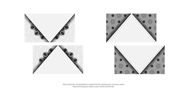 명함 디자인 만다라와 흰색 색상입니다. 텍스트와 검은색 장식품을 위한 장소가 있는 세련된 명함.