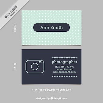 Business card on a dots background