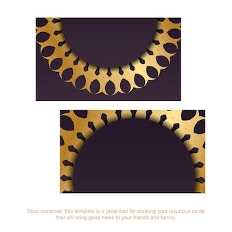 Визитная карточка бордового цвета с золотым орнаментом мандалы для ваших контактов.