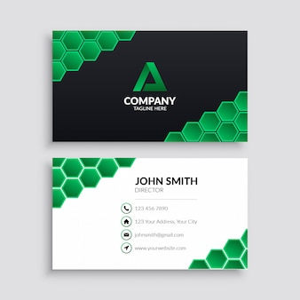 Business card template with green hexagon pattern