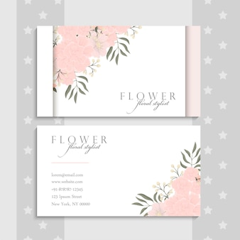 Business card template with pink flowers.