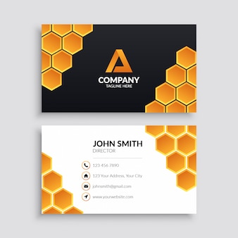 Business card template with yellow hexagon pattern