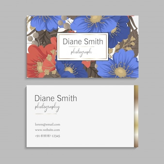 Business card with blue and red flowers