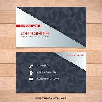 Business card with decorative polygons in dark tones
