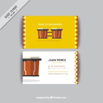 Визитная карточка с барабанами в течение музыкальной студии