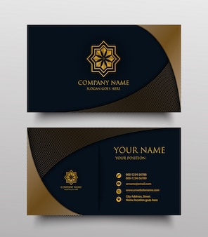 Business card with gold floral logo and place for text