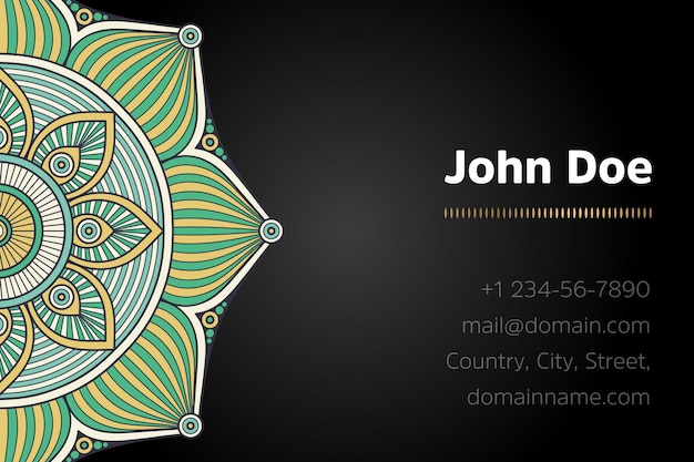 Business card with gold mandala design