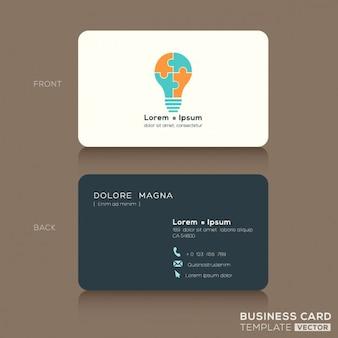 Idea del biglietto da visita creative design template con la luce jigsaw puzzle simbolo blub