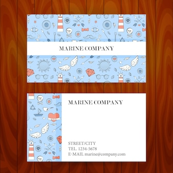 Business card with marine sea sketch hand drawn background. vector illustration of brand identity over wooden texture for marine company