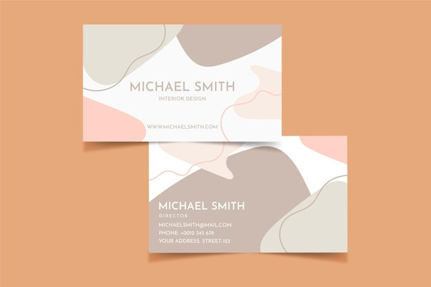 Business card with pastel-colored stains