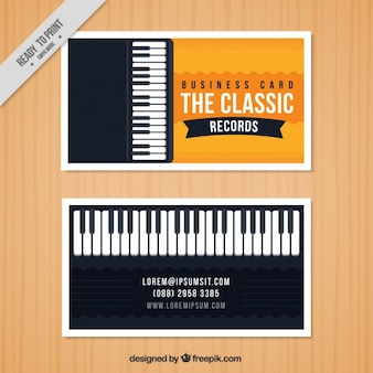 Business card with a piano for a music studio