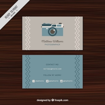 Business card with a vintage camera illustrated