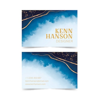 Business card with watercolor wash and golden splashes