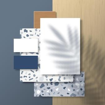 열대 야자수 잎 그림자 오버레이가있는 terrazzo 패턴 및 목재 타일 표면의 명함 및 전단지