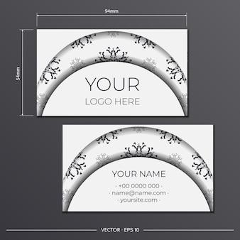 Визитные карточки белого цвета с великолепными векторными узорами с узорами мандалы. дизайн визитной карточки с орнаментом монограммы.