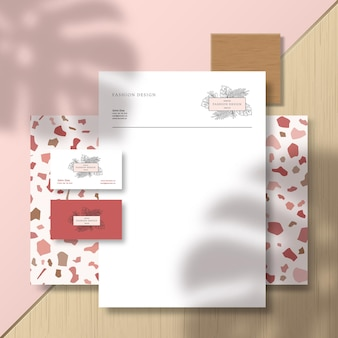 Business cards and letterhead on terrazzo pattern tile and surface