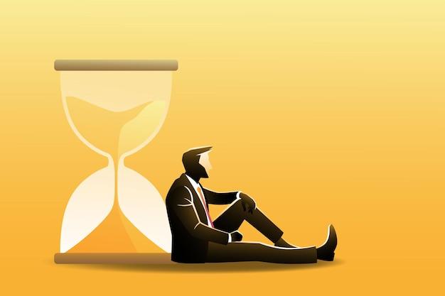 Бизнес-концепция, бизнесмен сидит, откинувшись на песочные часы, ждет чего-то