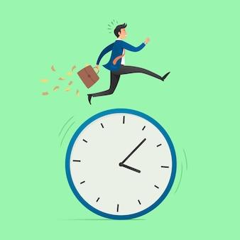 Business concept. businessman running on a big clock.