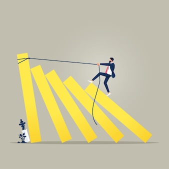 Business concept of a businessman trying to stop domino effect