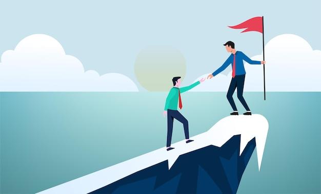 비즈니스 개념 리더십과 팀워크. 지도자는 다른 사람이 절벽을 올라가 목표에 도달하도록 도와줍니다.
