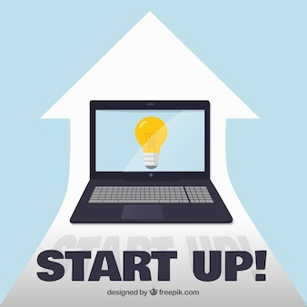 Business concept with laptop and bulb