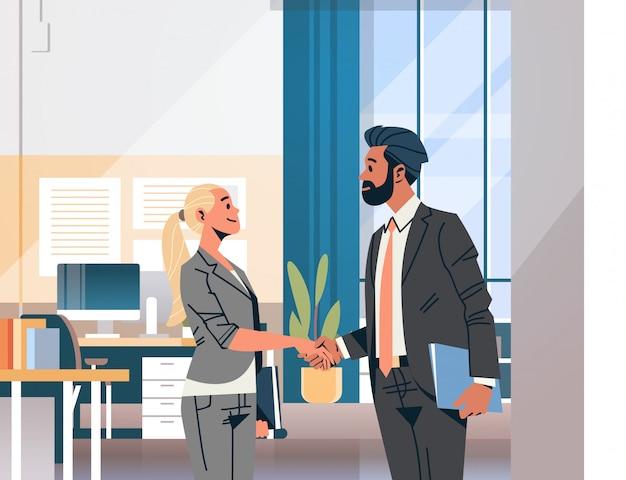 Business couple handshake