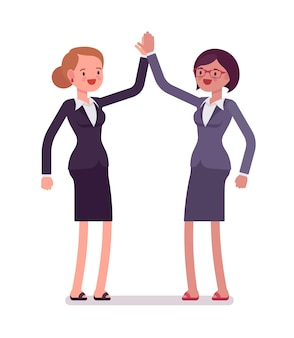 Business female partners giving high five