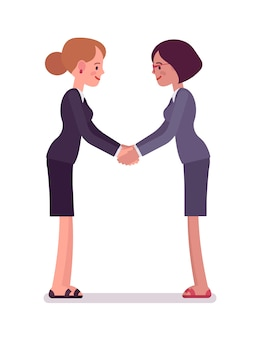 Business female partners handshaking with both hands