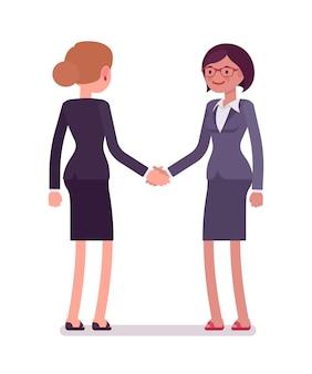 Business female partners handshaking