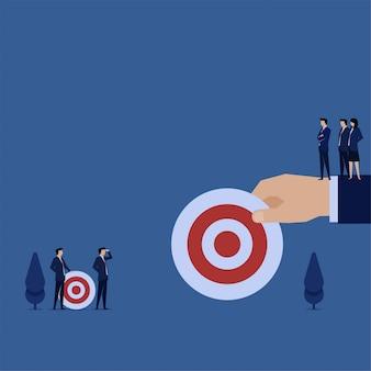 Business flat hand hold bigger target than other metaphor of big dream big target.