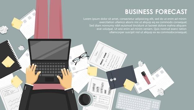 ノートパソコンとコーヒーのビジネス予測の概念