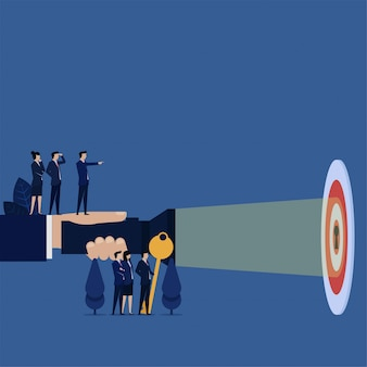 Business hand hold flashlight for keyhole on target metaphor of clear target.