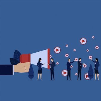 Business hand hold megaphone spread video icons metaphor of video promotion advertising.