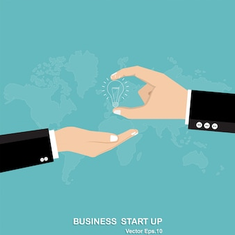 Business hand holding light bulb