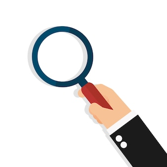 Business hand holding a magnifying glass