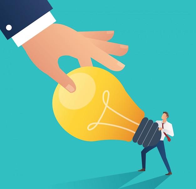 Business hand stealing idea light bulb. plagiarism