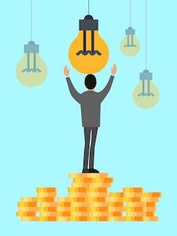 Бизнес идея финансовых вложений. бизнесмен тянется к лампочке, стоящей на стопках монет