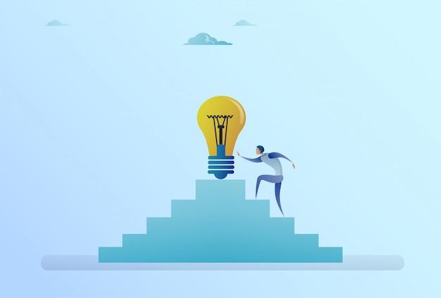 Business man climbing stairs up to light bulb new idea development concept