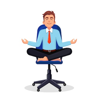 Business man doing yoga at workplace in office worker sitting in padmasana lotus pose meditating