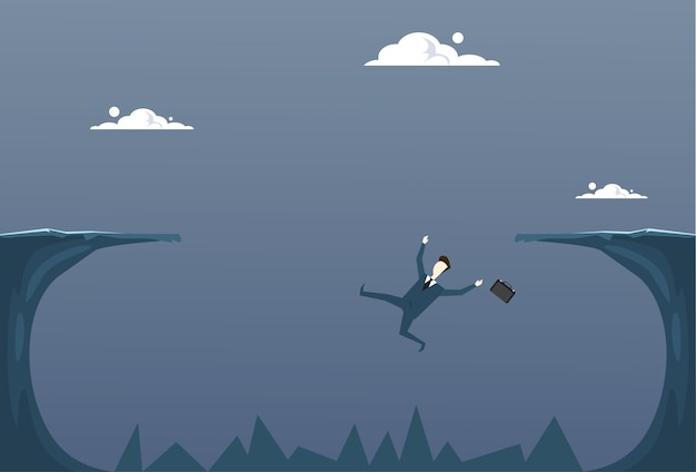 Business man falling in cliff gap