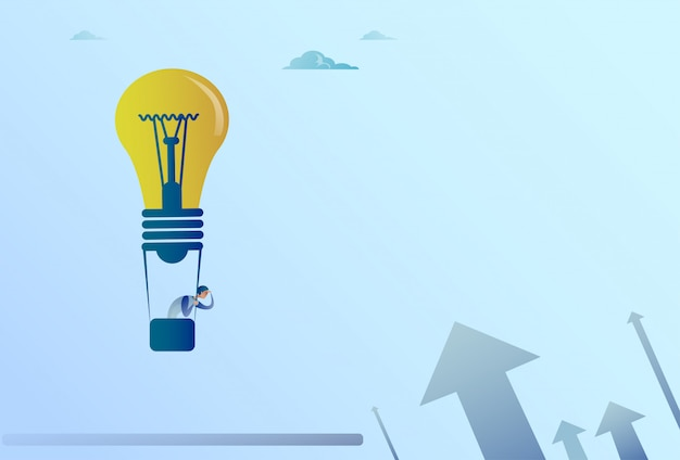 Business man flying on light bulb air balloon looking with binocular on arrows up finance growth con