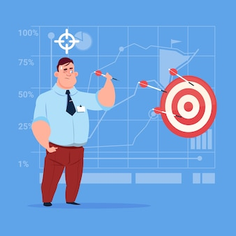 Business man hold arrow hit target successful goal concept