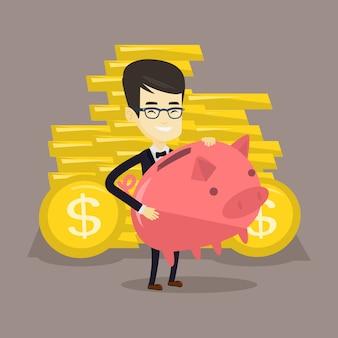 Business man holding big piggy bank.
