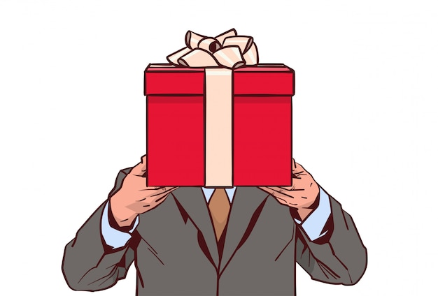 Business man holding red gift box isolated