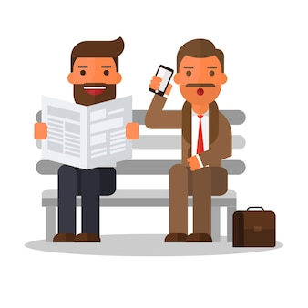 Business man reading newspaper and man using smartphone
