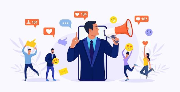 Деловой человек кричит в мегафон и молодые люди, последователи окружают его значками социальных сетей. влиятельный человек или блоггер на экране телефона. интернет-маркетинг, продвижение в соцсетях, smm