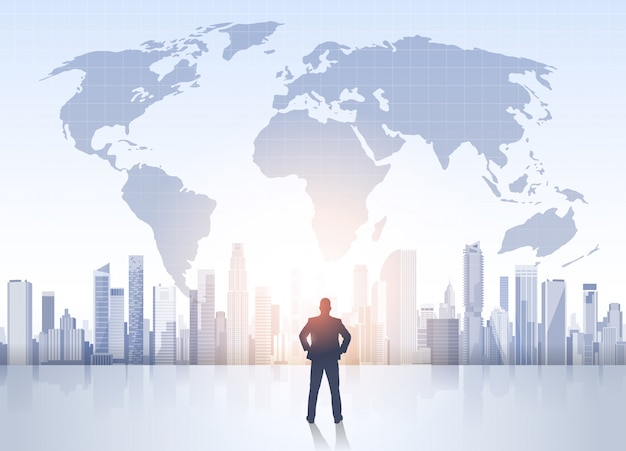 Business man silhouette over city landscape world map modern office buildings