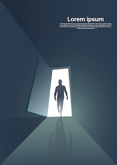 Business man silhouette standing at door entrance new opportunity concept