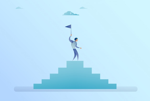 Business man on stairs top holding flag success concept