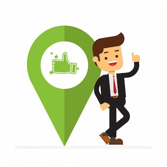 Business man stand next to a large map pointer